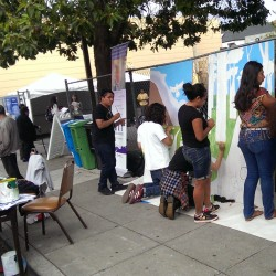 community working on mural