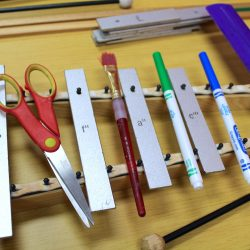 art supplies on a xylophone