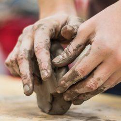 hands wedging clay
