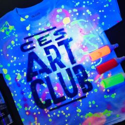 Art Club T-shirt made with blacklight and splatter paint