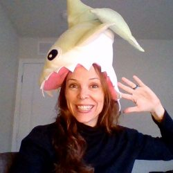 woman with shark on her head