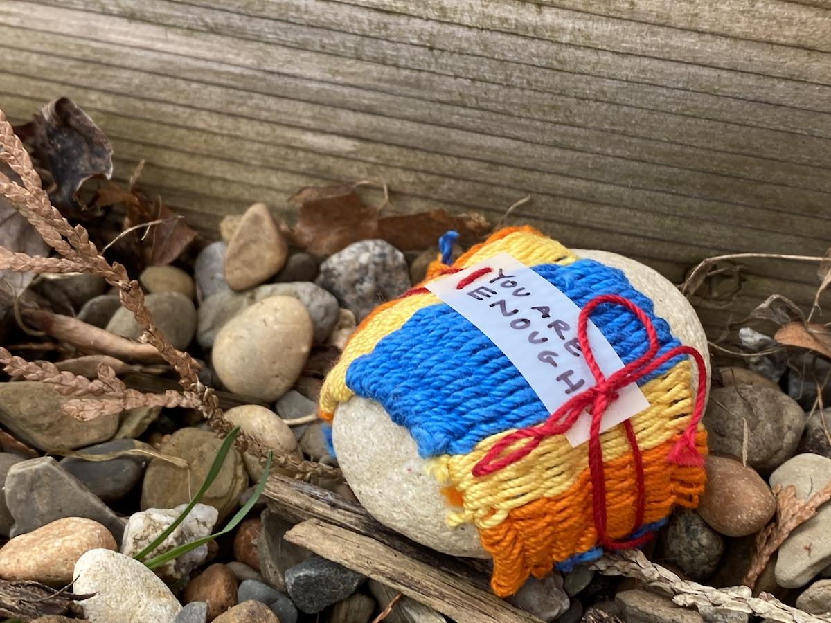 pebble yarnbombed