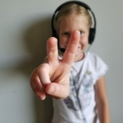Kid holding up 2 fingers