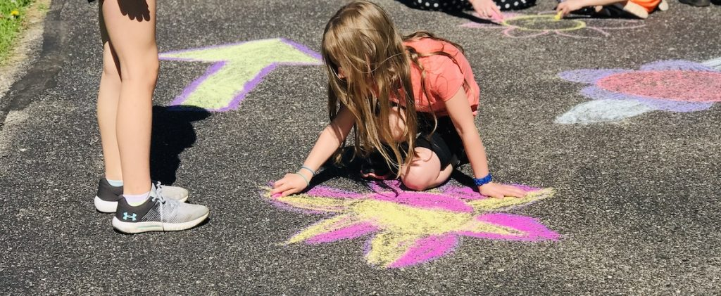 Student Drawing with Chalk