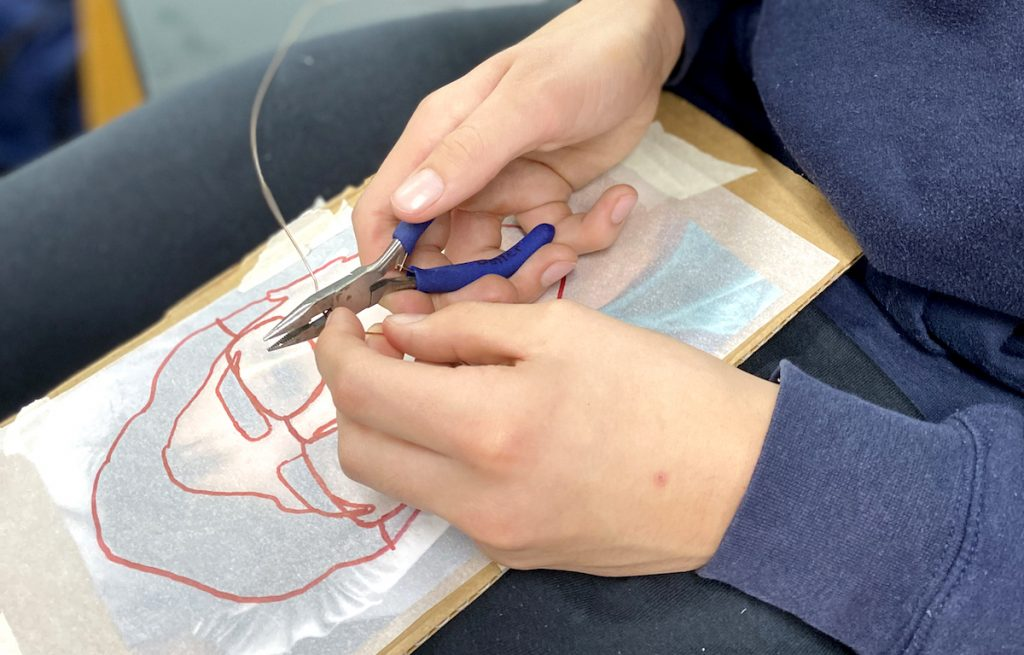 Student working with wire