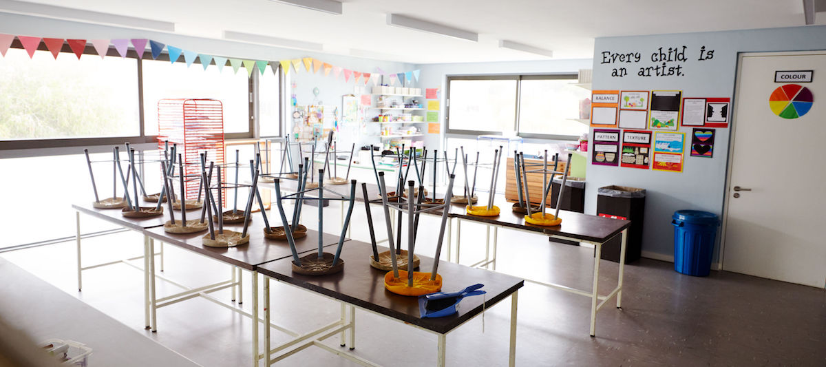 Empty Art Classroom In Elementary School With Chairs Stacked On Tables