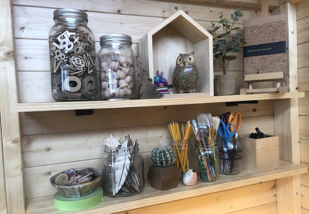 art supplies on a shelf