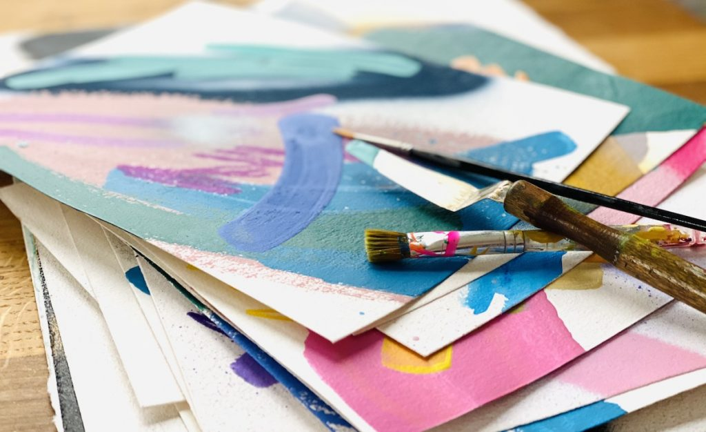 paper and paint brushes