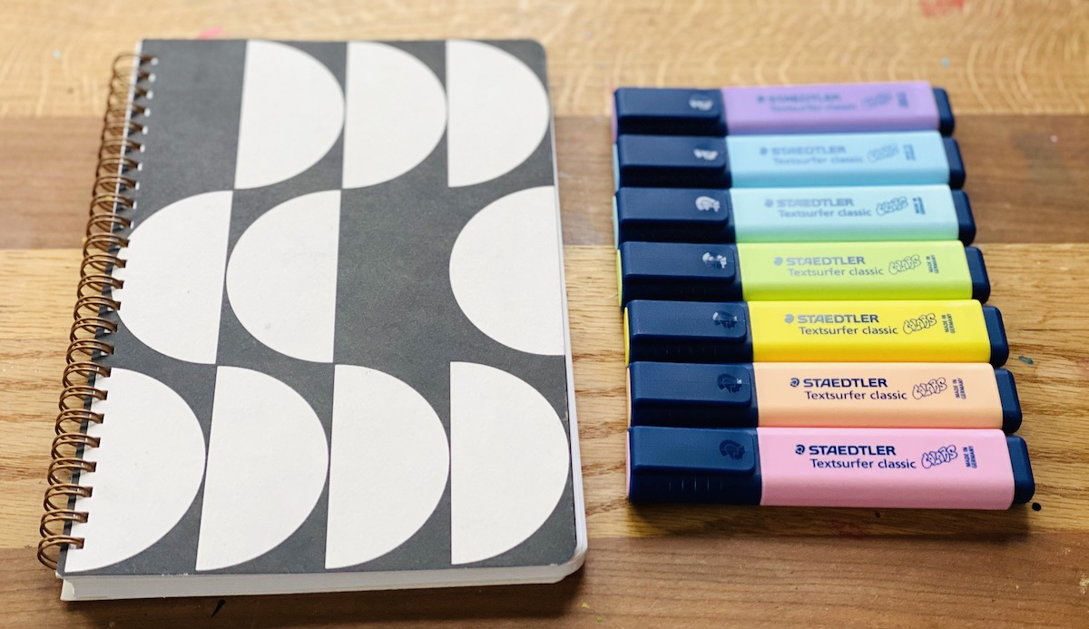 notebook and markers