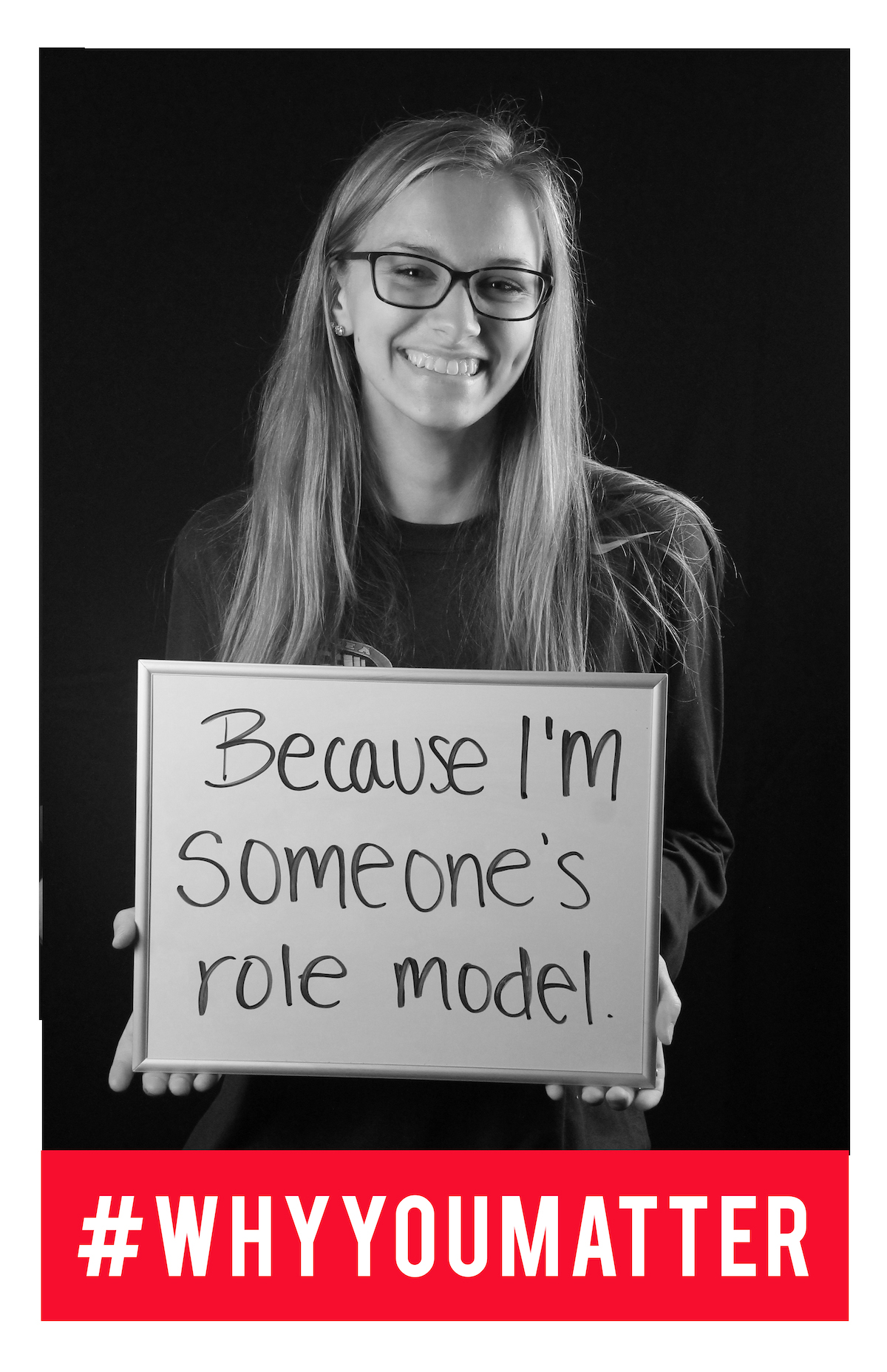 image of student holding sign 'because I'm someone's role model.'