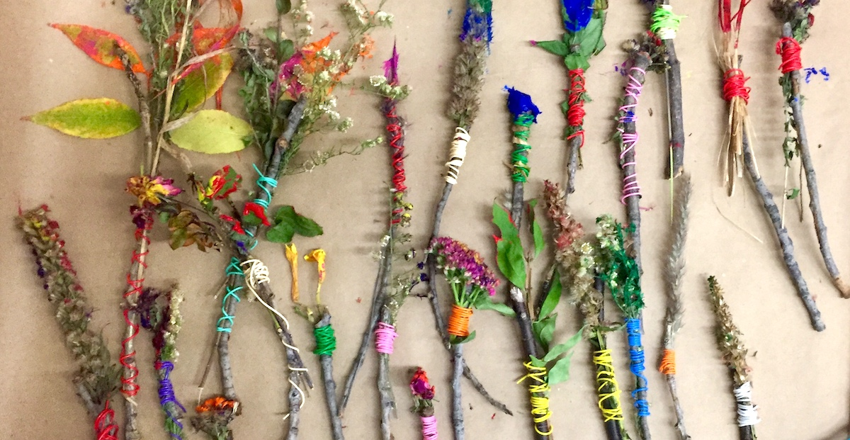 natural paintbrushes made of sticks and flowers