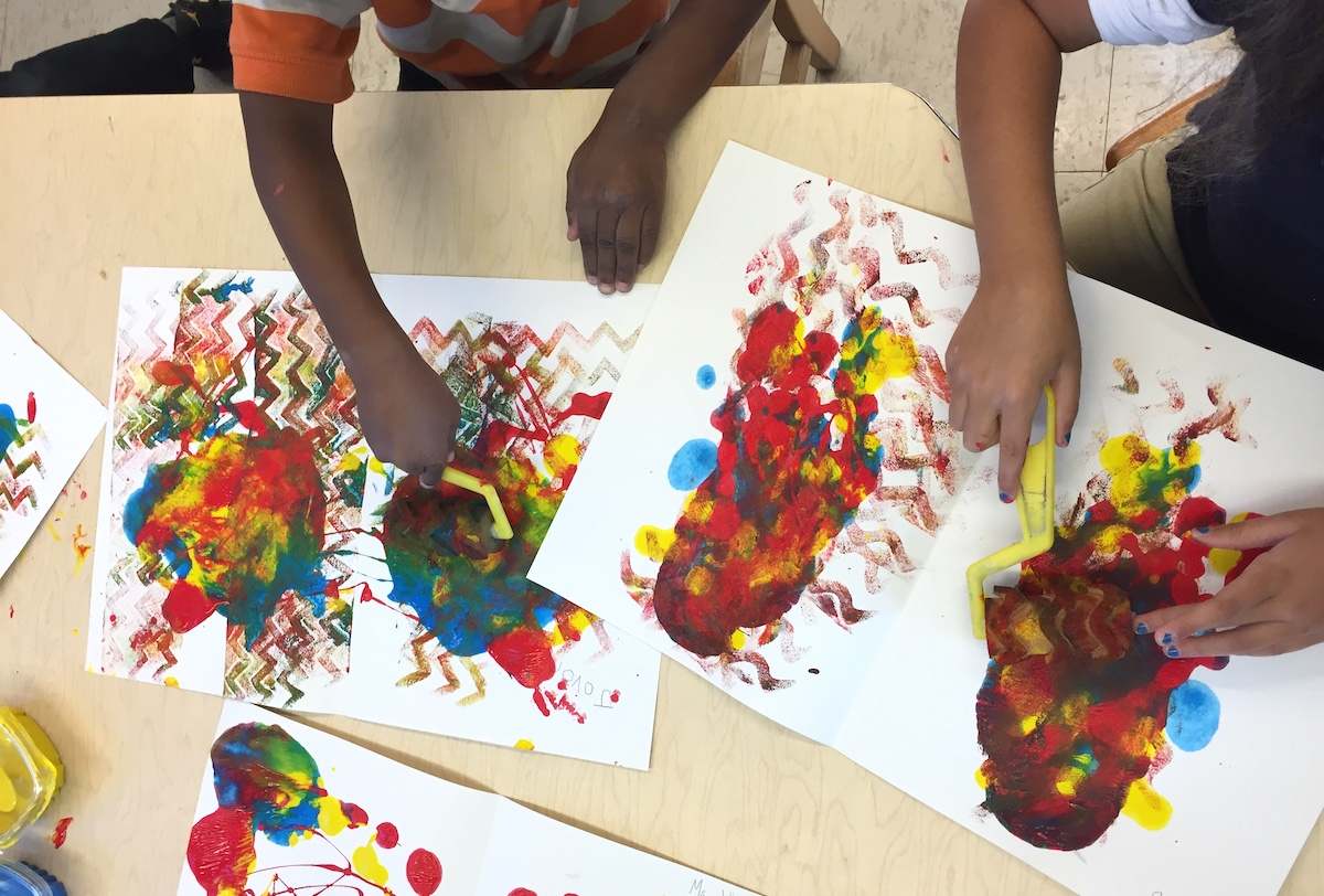 students making artwork with the primary colors red, yellow, and blue