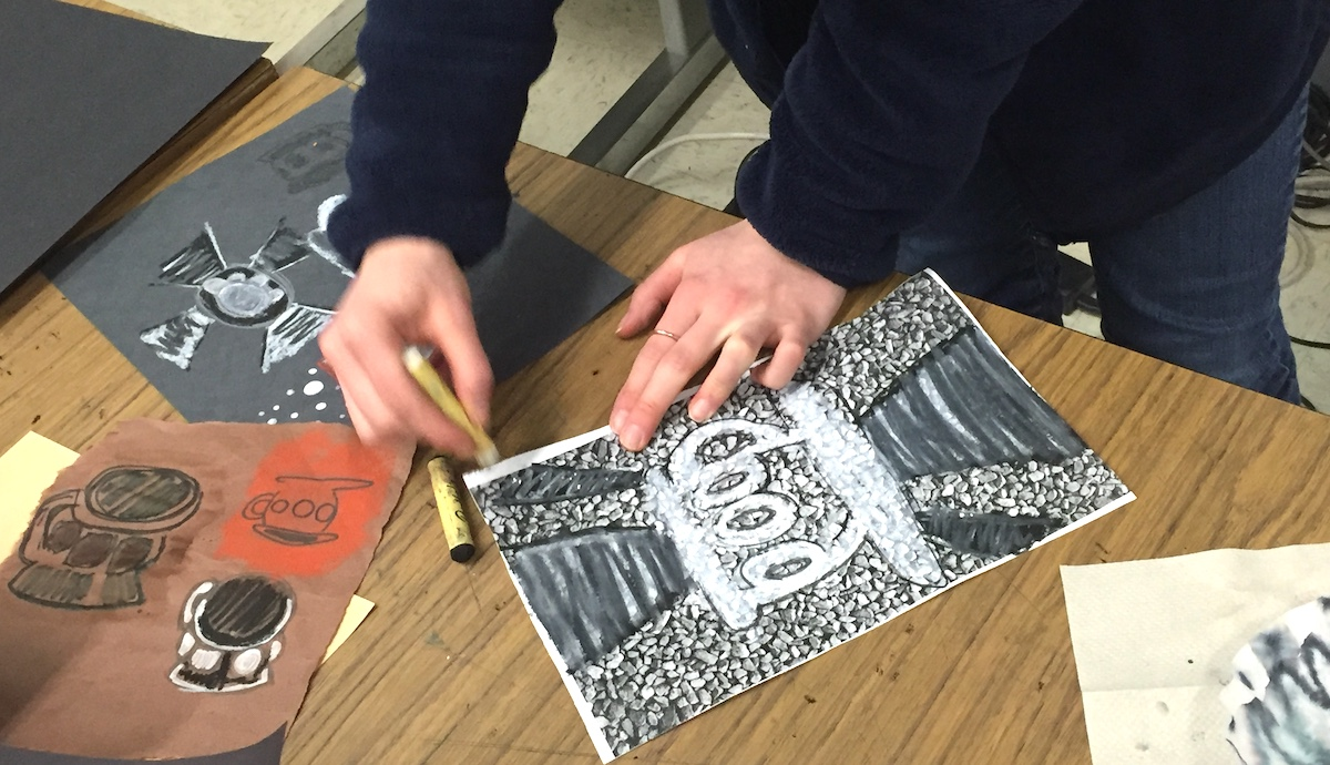 artist working on a black and white artwork