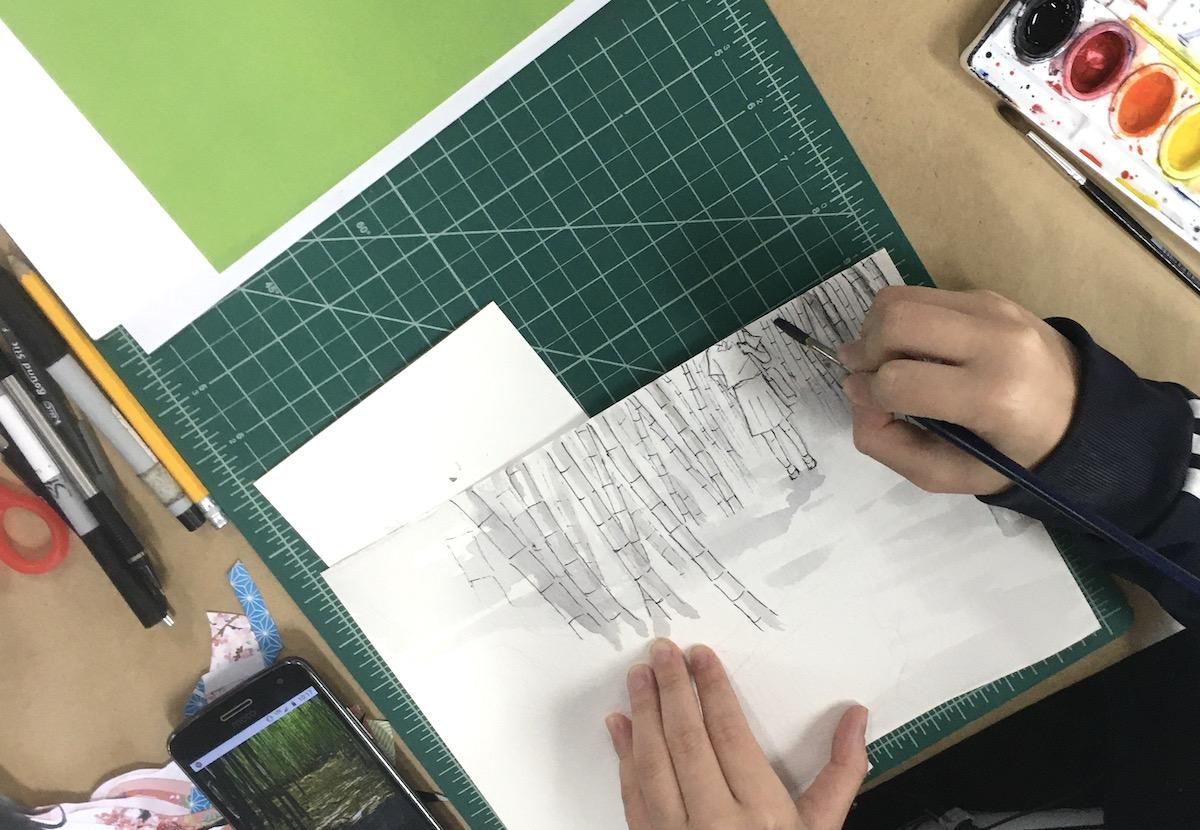 student working on landscape artwork